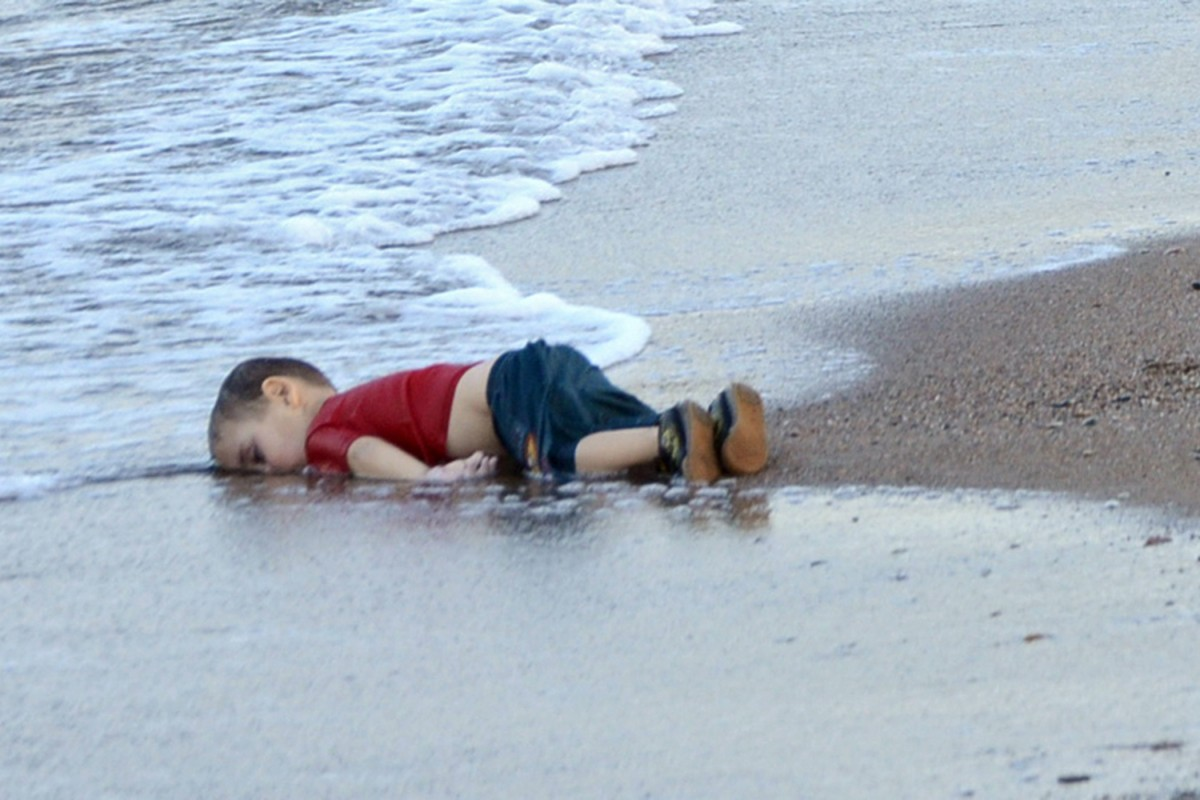 Image result for image of syrian boy on beach