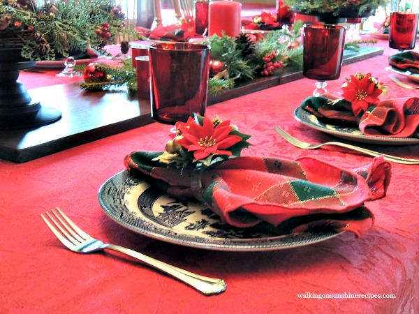 Dining room table set for Christmas with Blue Willow Plates and red stemware from Walking on Sunshine.