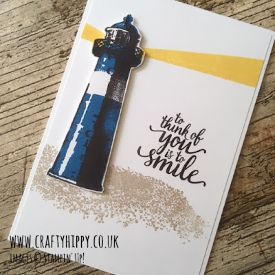 This image shows a lighthouse themed handmade card, made using the High Tide stamp set and some Daffodil Delight ink from Stampin' Up!