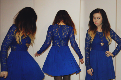 a girl with ombre hair, francesca sophia, wearing an electric blue lace dress with an exposed back, and twirling in front of the camera
