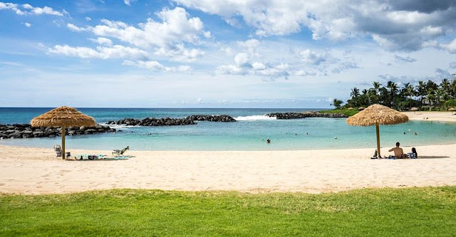 Relaxing under Thatched Umbrella at Hawaii Beach