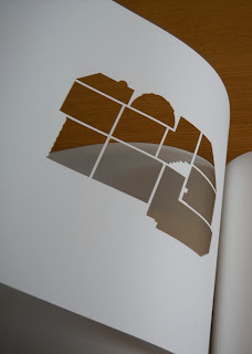 A single page from this book, cut out to show the layout of a house.