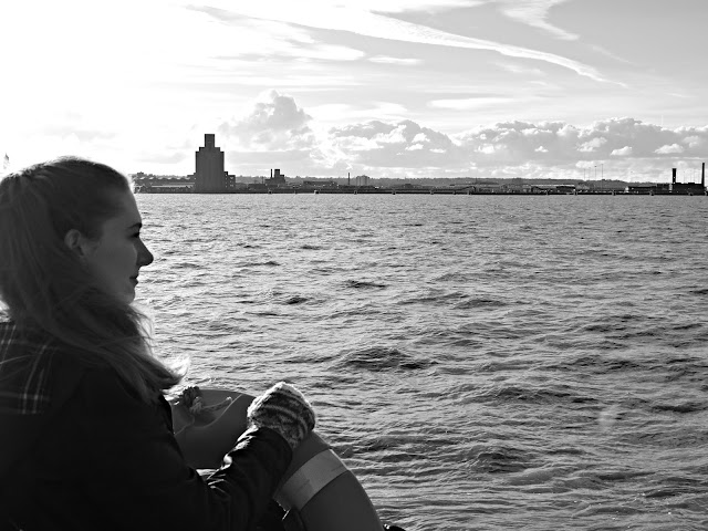 girl overlooking the mersey river