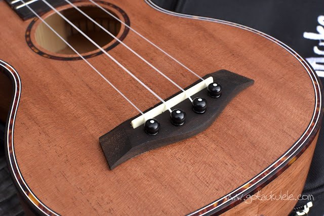 Muke MS-10 Soprano Ukulele bridge