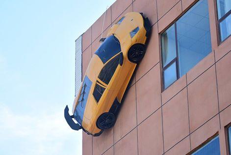 'Luxury car' races up building, entertainment news