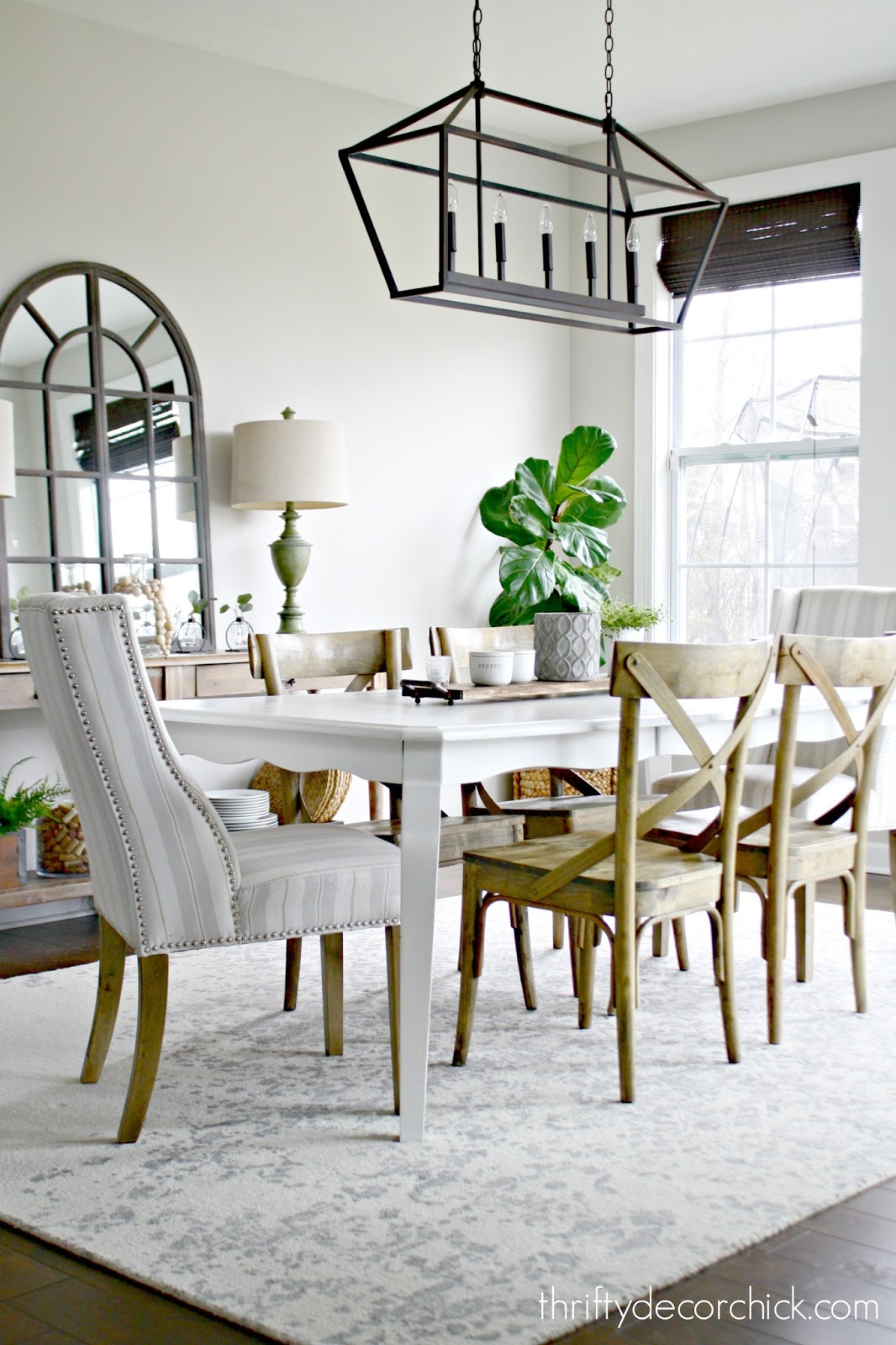 Pretty dining area with wood and white furniture