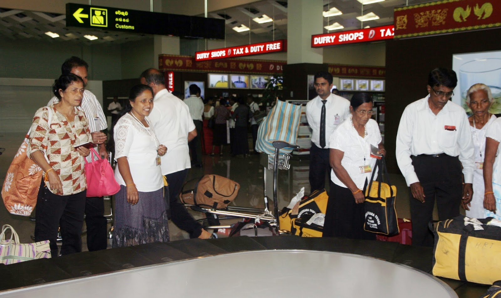 Mihin Lanka passengers collecting their luggage at the MRIA terminal building.