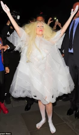 Photos Lady Gagas makes bizarre entrance as she lands in