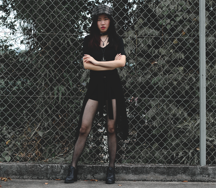 Brunei blogger May Cho in grunge chic fashion, plaid flatcap, all black, fishnet stockings, leather choker