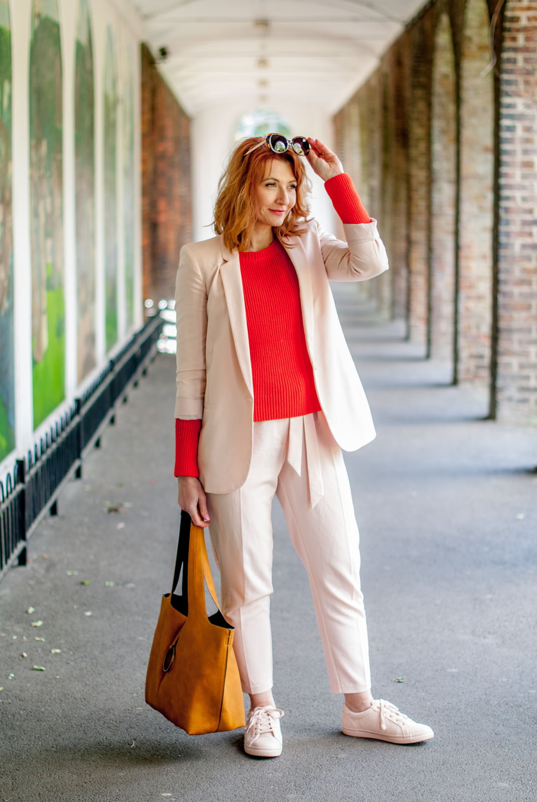 Bright spring/summer outfit: Blush pink trouser (pants) suit \ matching sneakers \ tomato orange red sweater \ yellow ochre suede hobo bag \ tortoiseshell sunglasses | Not Dressed As Lamb, over 40 styleBright spring/summer outfit: Blush pink trouser (pants) suit \ matching sneakers \ tomato orange red sweater \ yellow ochre suede hobo bag \ tortoiseshell sunglasses | Not Dressed As Lamb, over 40 style