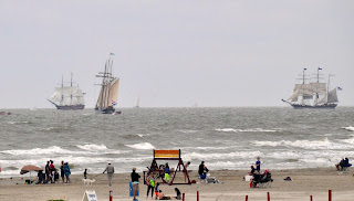 three tall ships under sail