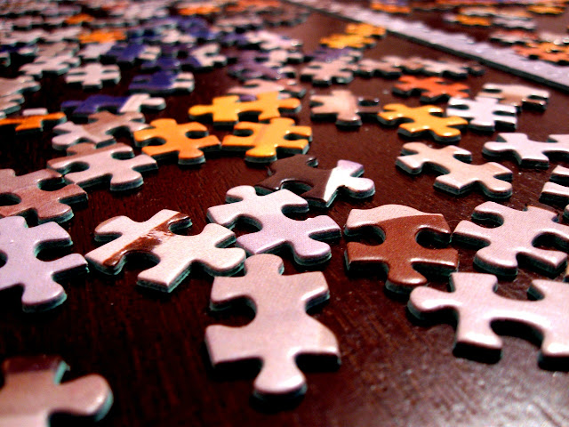 Close up of puzzle pieces on a table