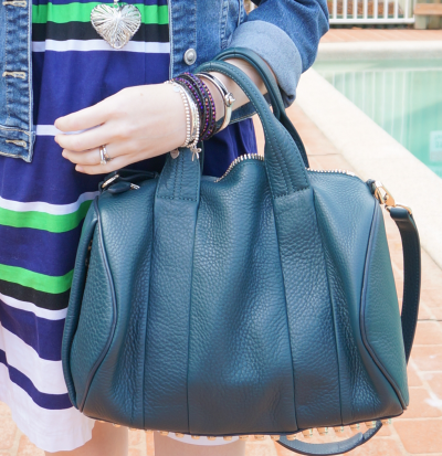 Alexander Wang dark Argon Rocco bag worn with green and blue stripes