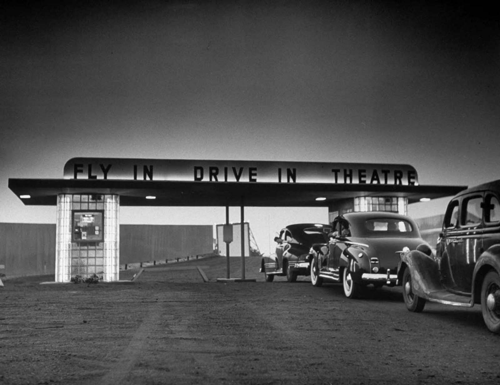 Some customers arriving by car at area Fly-In Drive-In Theatre.
