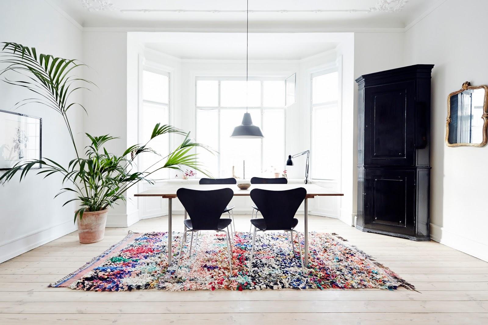 houseplant. fritz hansen chair, oriental rug, danish modern, dining table