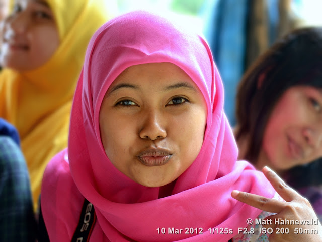 people, Muslim girl, street portrait, headshot, Indonesia, Sumatra, Medan, young beauty, hijab, V sign