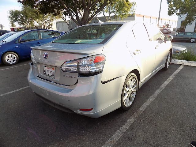 Rear-ended Lexus HS250h before auto body repairs at Almost Everything Auto Body.