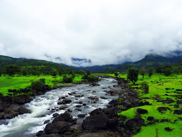 River. Hills. Clouds. Monsoons. Dehena. Maharashtra. India