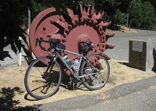 pep's bike next to a Pelton Wheel, Northstar Mining Museum, Grass Valley, California