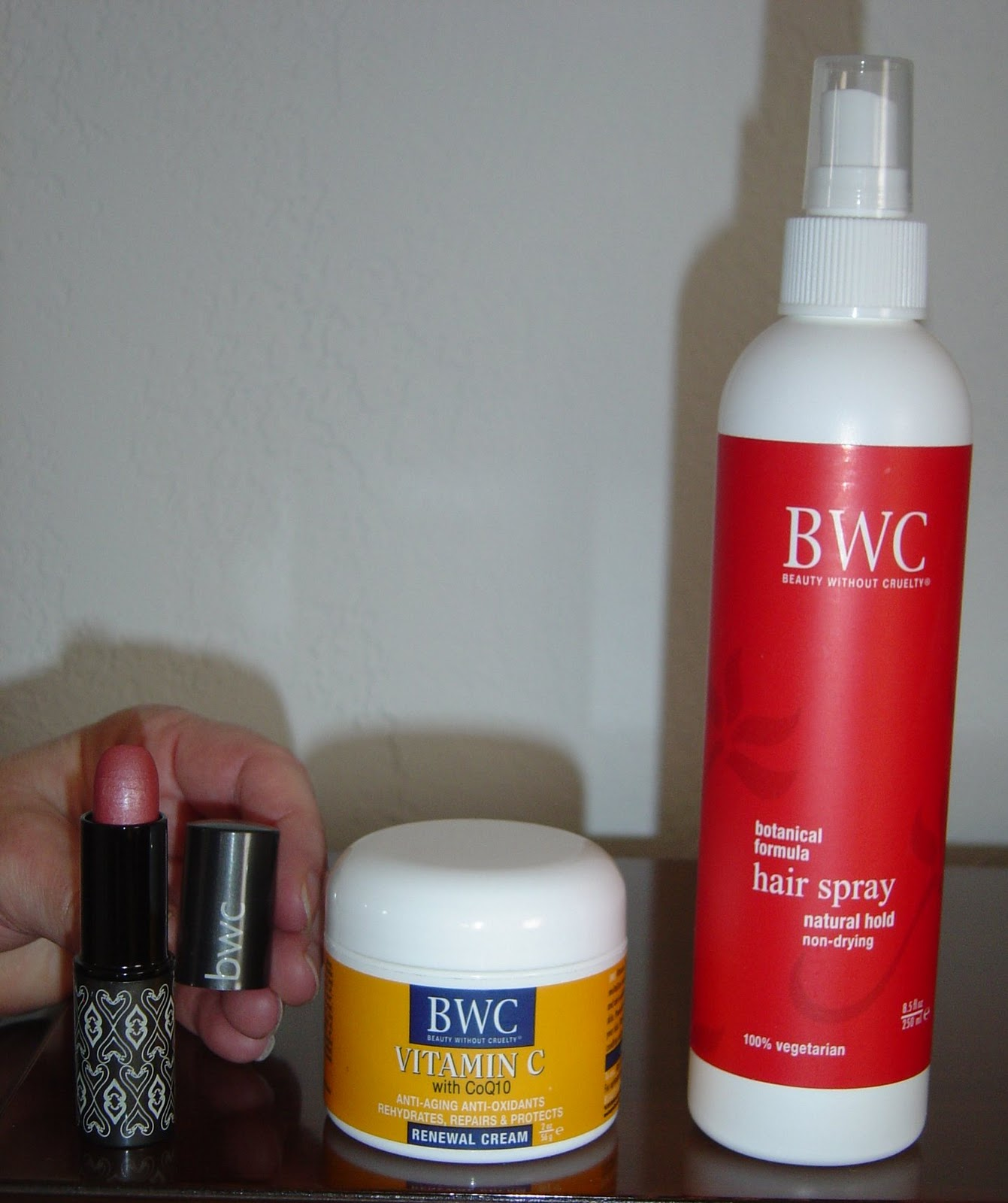 Beauty Without Cruelty Products lipstick, moisturizer and hairspray