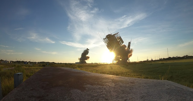 Delta II towers collapse after detonation at Space Launch Complex-17, July 12, 2018 at Cape Canaveral Air Force Station. Brig. Gen. Wayne Monteith, commander of the 45th Space Wing, activated the detonator. (U.S. Air Force photo by Airman 1st Class Dalton Williams)