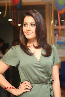 Actress Raashi Khanna Stills in Green Short Dress at Mirchi 95 Suno Aur Mercedes Jeeto Contest  0049.JPG