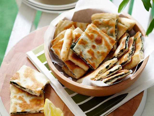 Take one round of the dough and roll into a Barbecued spinach gozleme recipe