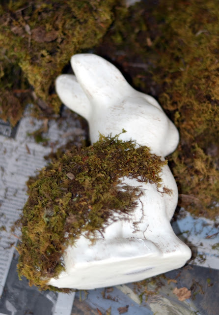 putting moss on a plain bunny figurine