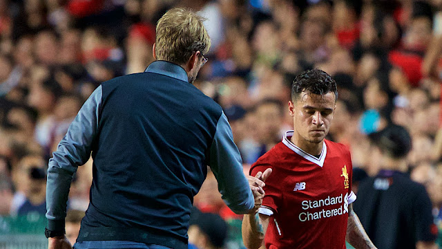 Klopp with Philippe Coutinho