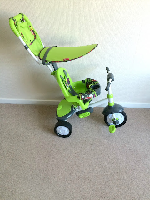 green fisher price trike