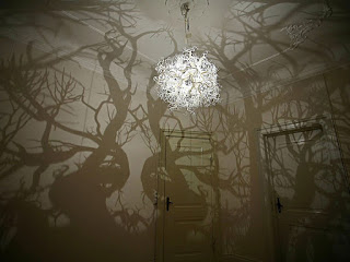 Chandelier with light and shadows resembling trees