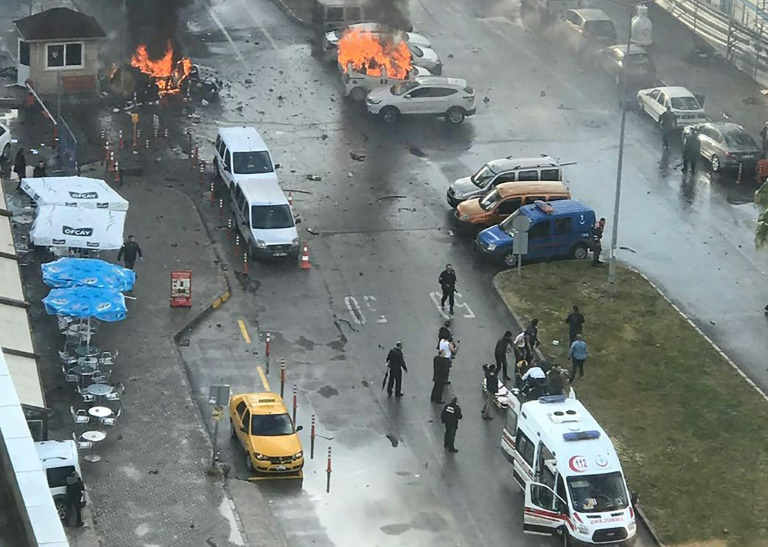 Cars burn in the street at the site of an explosion in front of the courthouse in Izmir, western Turkey on January 5, 2017.
