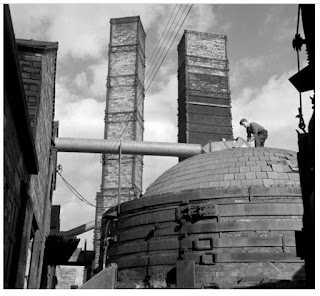 Beehive Brick and Tile kiln A worker on top of pottery kiln in the yard  of Wheatly Brick & Tile Co Photo: source unknown  Date: mid 1950s