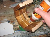 Apply a little bit of glue along the back groove of the clock case