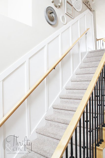 DIY board and batten staircase makeover. DIY stair makeover. How to hang board and batten on stairs. Staircase board and batten tutorial. Staircase ideas. Entry way decor and decorating ideas. Staircase decor and decorating ideas. Two story entryway ideas. Two story entry way ideas.