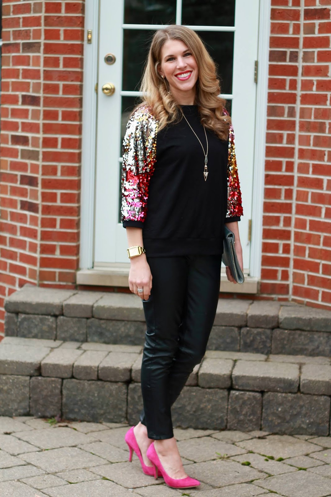 sequin sleeve black top, black leather pants, grey envelope clutch, pink heels,