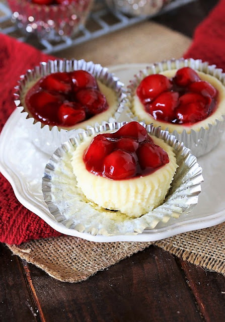 Plate of Three Mini Cherry Cheesecakes Image