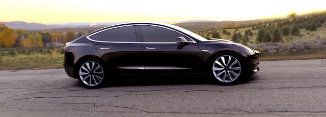 Tesla Model 3 roadside profile shot car