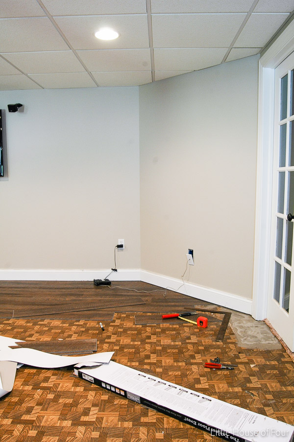 The basement makeover continues with new paint and floor.  - Littlehouseoffour.com