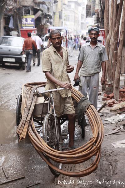 street workers handling steel