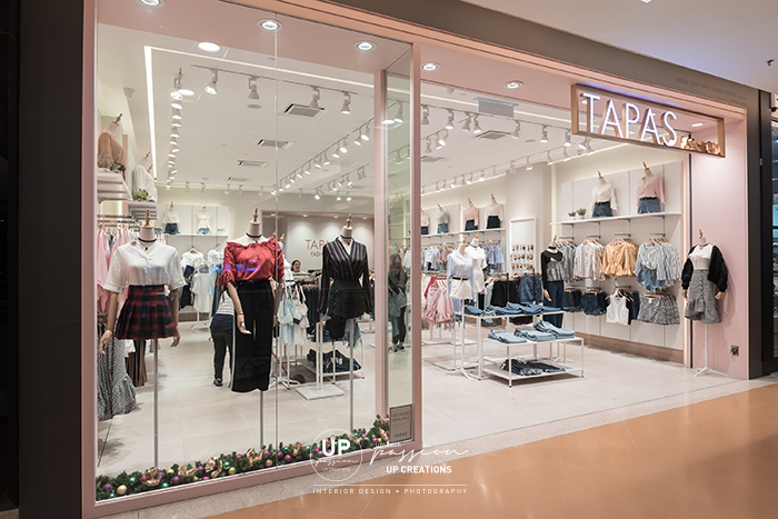 Sunway pyramid tapas fashion shopfront in grey color stone texture tiles finish with bulkhead in pastel pink color spray paint finish and backlit signage with bronze color frame
