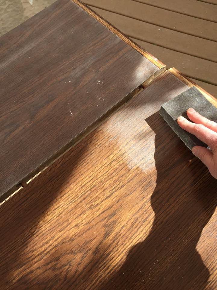 Lightly sanding the surface in preparation for Chalk Paint.