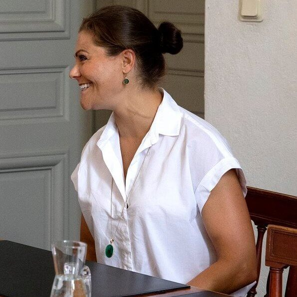 Crown Princess Victoria attend to the EU Arctic Forum. green earrings and crystal necklace