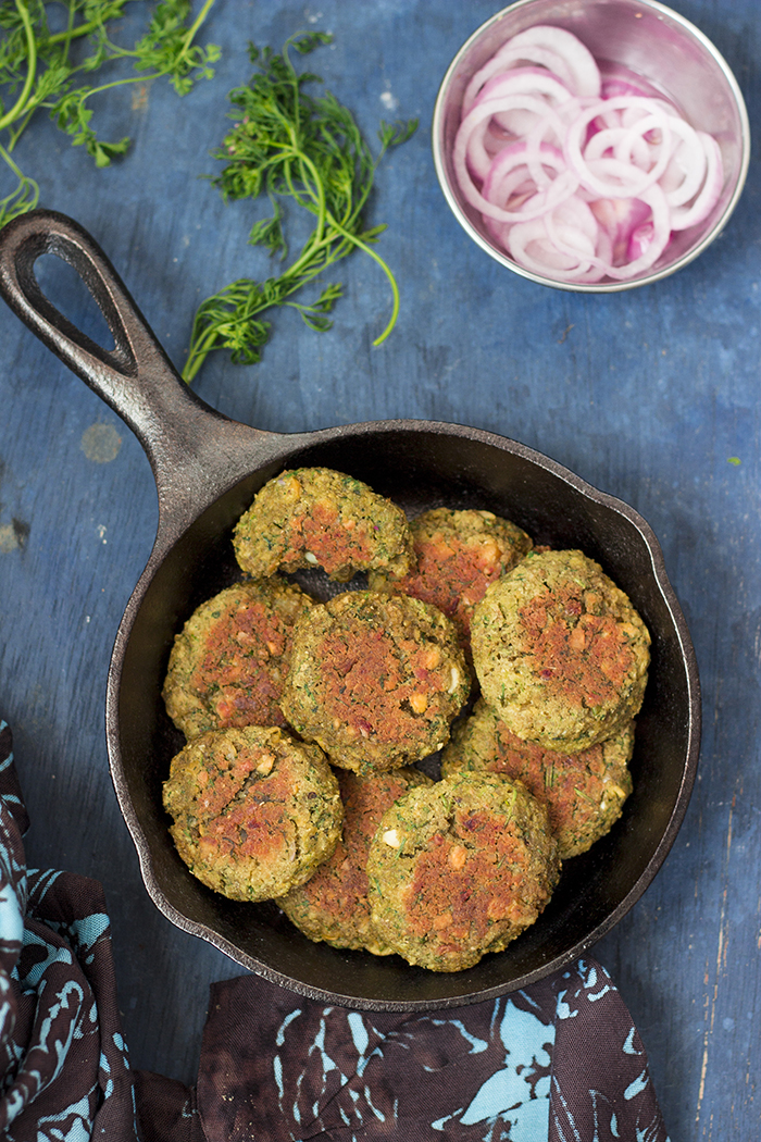 Baked chickpea falafels and hummus in a beetroot flatbread