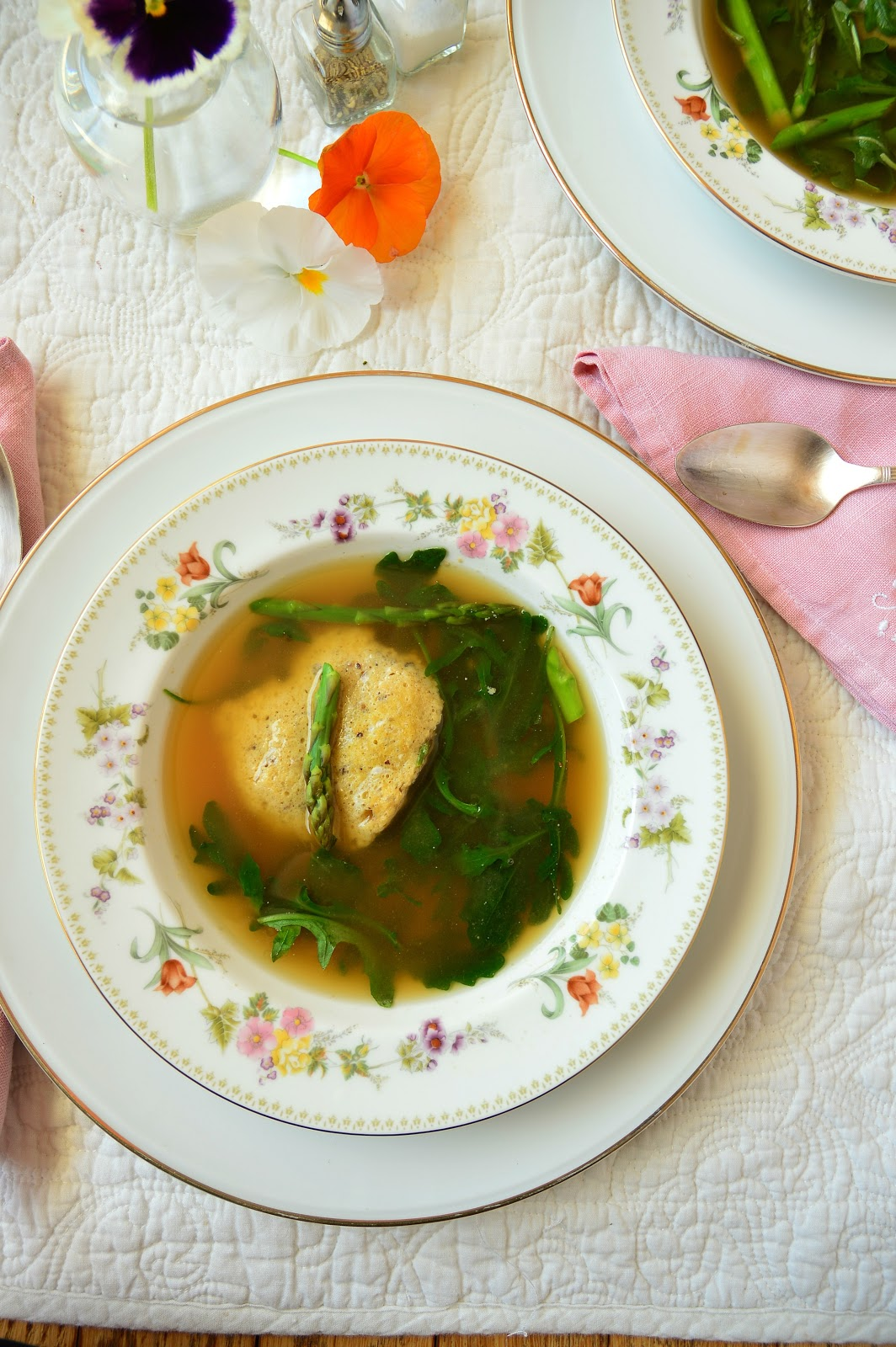 This springtime matzo egg drop soup is perfect. It solves the matzo ball dilemma of sinkers or floaters by using just matzo meal and eggs that are dropped by spoonfuls into the hot broth. This forms creative little matzo discs that I just love! #matzoballs #chickensoup #passoverrecipes www.thisishowicook.com