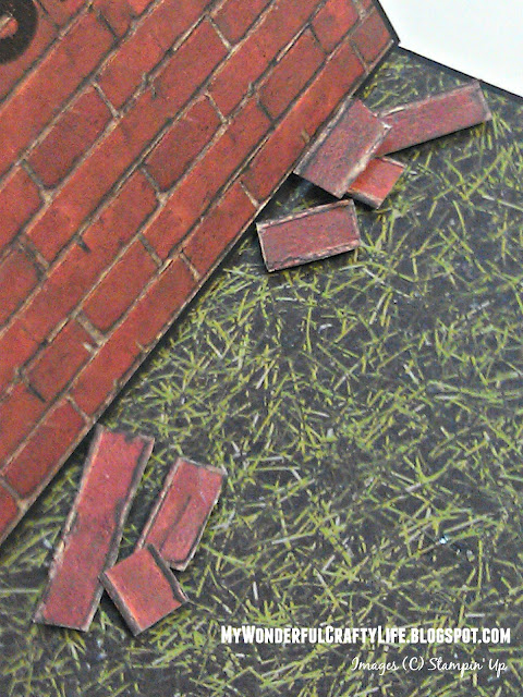 Hand cut bricks glued on grass paper to resemble fallen bricks
