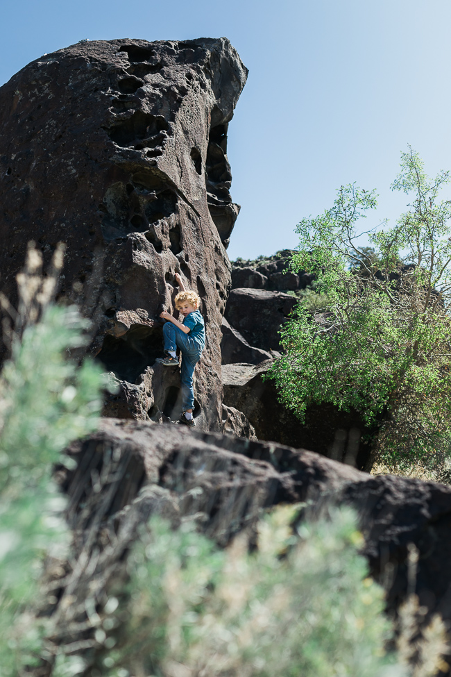 two boys exploring and bouldering in dierkes lake in Idaho in Shoshone State Park