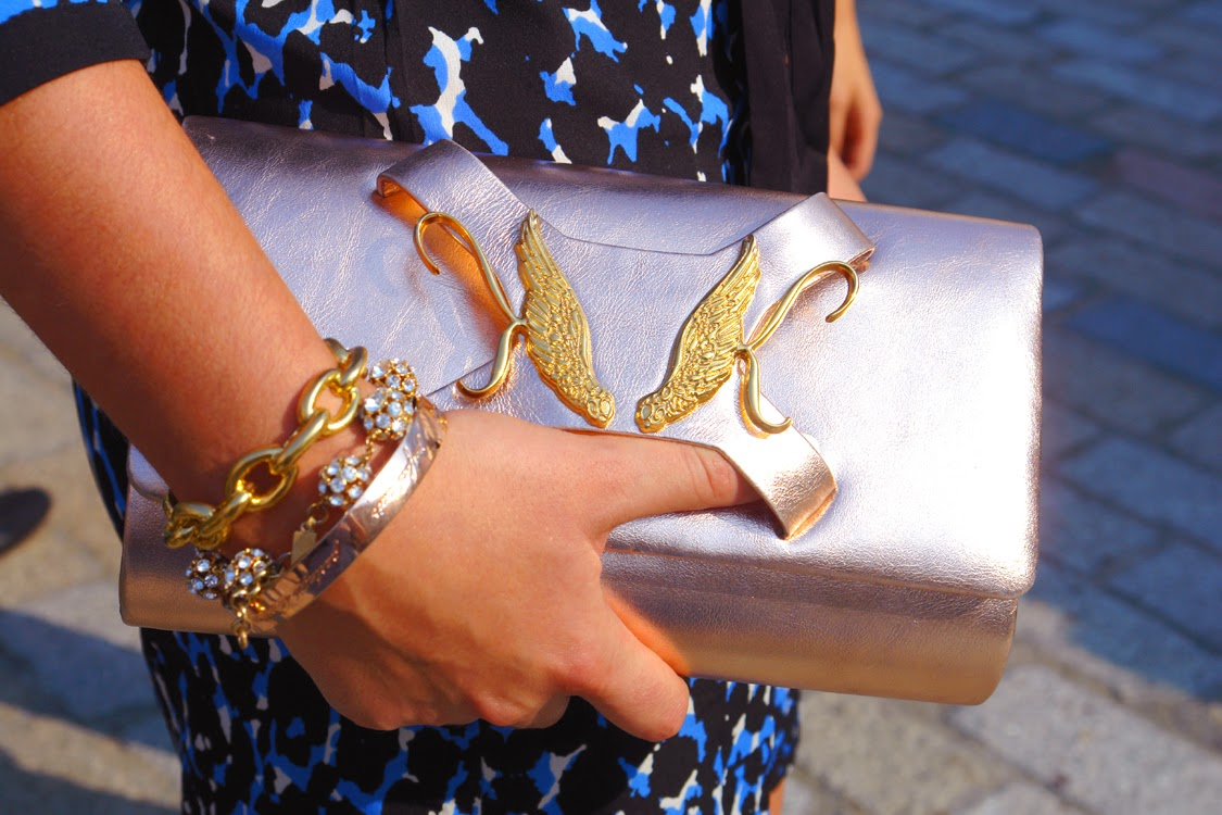 Karen K rose gold leather clutch bag at London Fashion Week
