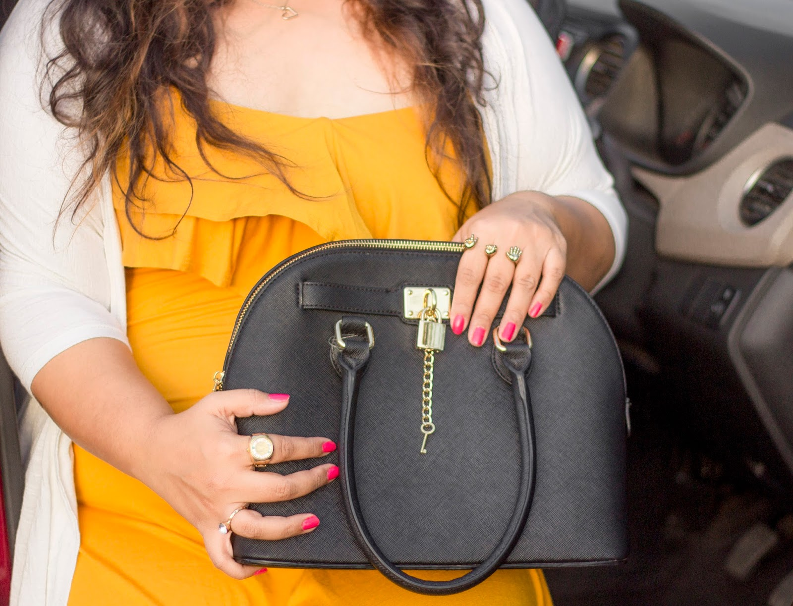 aldo black bag pink nails gold rings yellow dress