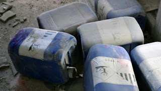 poisonous materials and weapons seized in Deir Ezzor